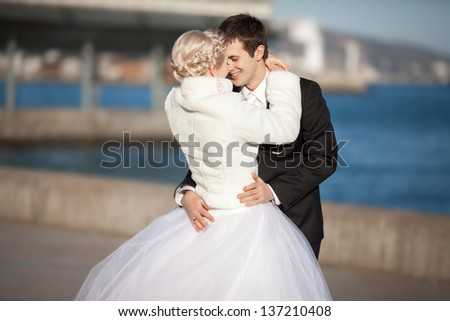 Wedding bride and groom dancing loving couple dance at winter bridal day Enjoy moment of happiness and having fun. playful newlywed family woman and man in love. gorgeous bride and handsome groom. - stock photo