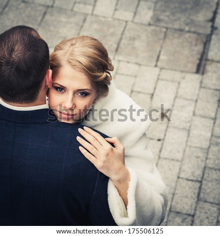 wedding. bride embraces the groom, and the background of the beautiful background tiles