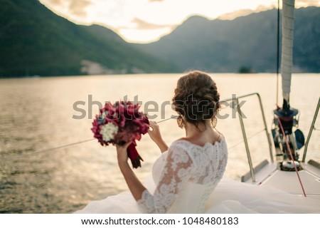wedding bride travel on yacht. honeymoon in Europe. Montenegro. #1048480183