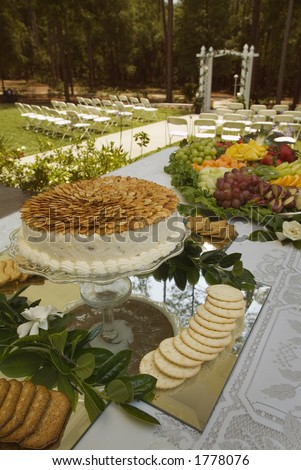 stock photo Wedding buffet food with chairs and aisle in background