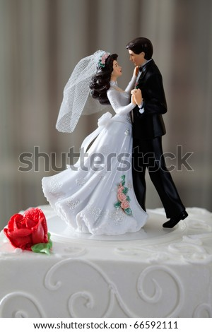 stock photo Wedding cake and topper with couple dancing