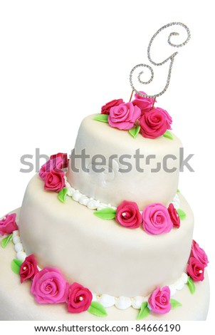 Wedding cake covered in ivory marzipan and decorated with pink roses