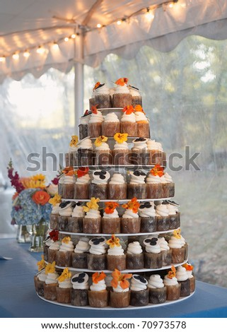 Wedding cake of cupcakes with flowers at reception