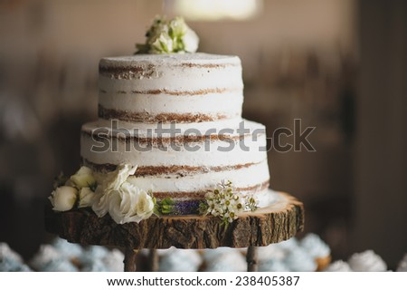 wedding cake on the wooden plate