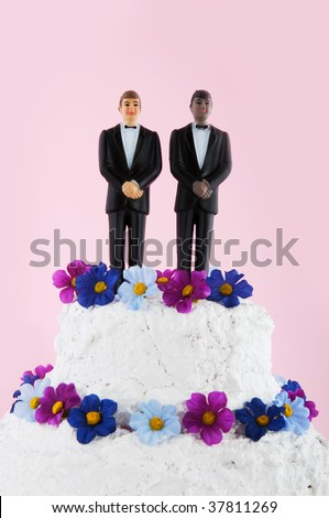 wedding cakes with flowers on top. stock photo : Wedding cake with flowers and homo couple on top