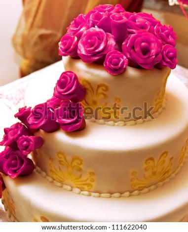 Wedding cake with fuchsia roses