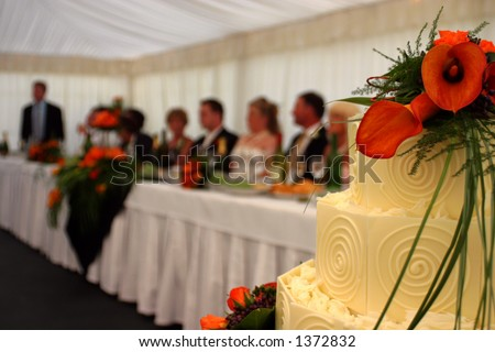 Wedding Cake with main table blurred in background