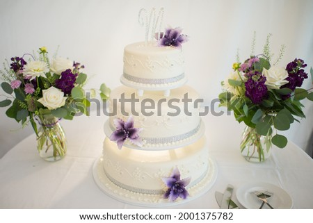 Wedding Cake with Three Tiers and Flowers Letter M Photo stock ©