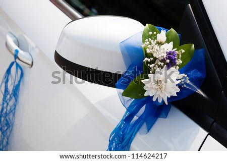 Wedding Car Decoration With Flowers And Ribbons Stock Photo