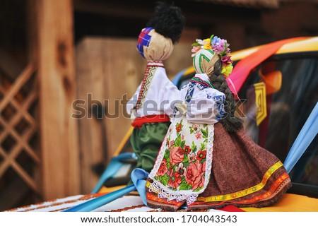 Wedding Car Decorations. Ukrainian doll-motanka or rag doll. Handmade textile doll ancient culture folk crafts tradition of Ukraine. Yarn. Folk doll. Motanka