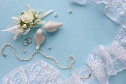 wedding card design in pastel colors. flowers, wedding ring and figurines of white birds. flat lay. congratulation. invitation
