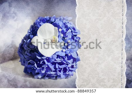 Wedding card with bouquet from blue Hydrangea and white Phalaenopsis