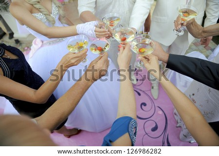 wedding celebration with glasses clink