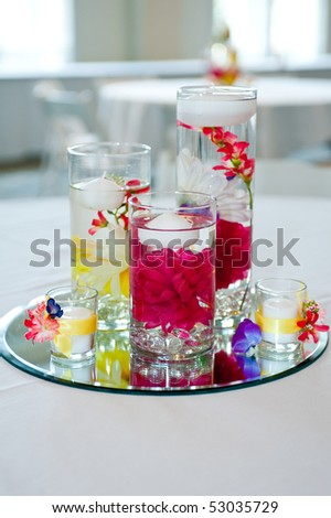 stock photo wedding centerpiece with floating candles and flowers