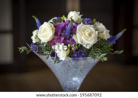 wedding centrepiece flowers white and purple