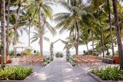 Wedding ceremony area setup on coconut garden near the beach is good idea