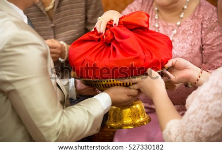 Shutterstock Wedding ceremony decoration.Wedding Dowry,The Dowry Marriage in Thailand.Wedding Thailand.money and rings.The Dowry Marriage in Thai Culture. Objects for Thai Engagement or wedding.