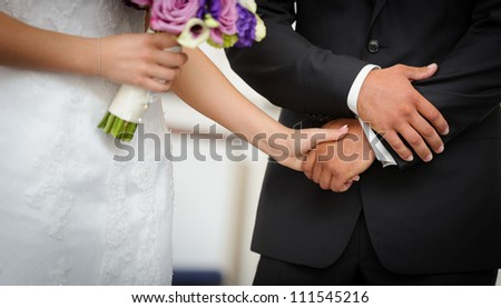 Wedding ceremony - holding hands