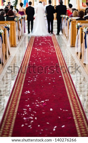 Wedding ceremony in church - focus on red carpet #140276266