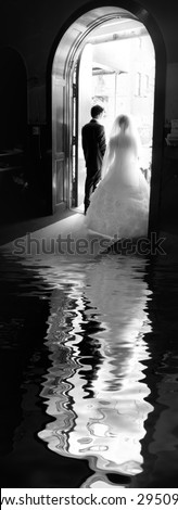 Wedding ceremony in church  - reflection in the water