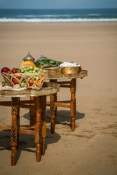 wedding ceremony on the ocean in Morocco, fruits and traditional sweets for treats
