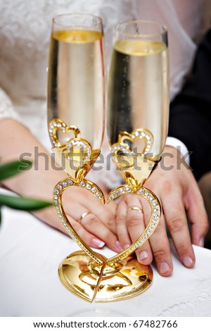 stock photo Wedding champagne glasses and bride and groom hands with rings
