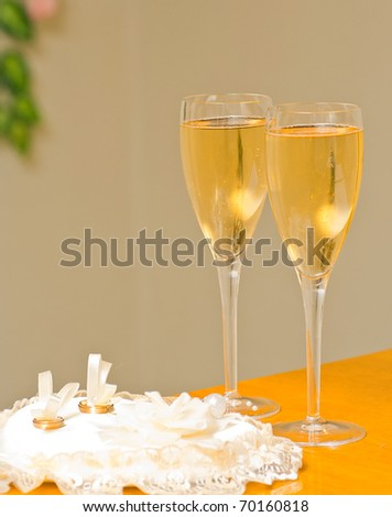 stock photo wedding champagne glasses and wedding rings