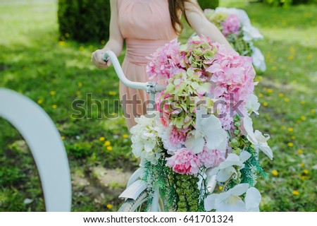 Wedding composition decoration in old vintage romantic style. Bride with white bike #641701324