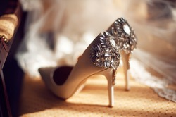 wedding concept. bride's shoes and veil