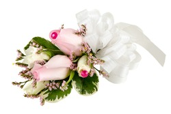Wedding corsage with pink roses isolated on white