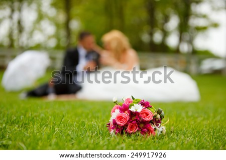 Wedding couple and flower bouquet