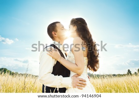 Wedding couple bride and groom in nature. sun shine through kiss