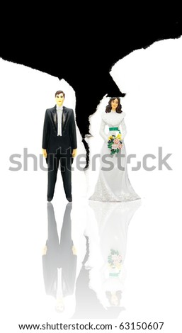 wedding couple figures and ripped paper (divorce concept) - stock photo
