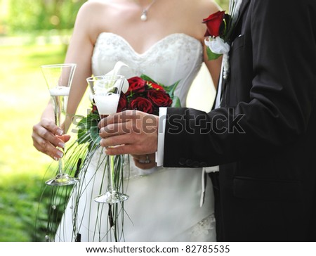 wedding couple holding glasses of champagne. selective focus - stock photo