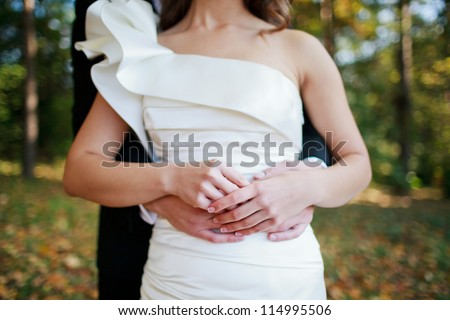 Wedding Couple Holding Hands on a field