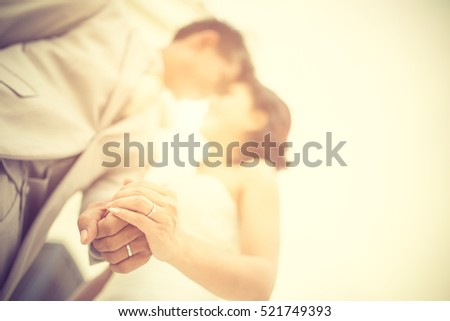 wedding couple holding hands on ...