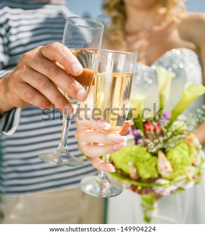 Wedding couple holding wine glasses  #149904224