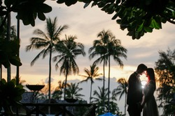 Wedding Couple In Love Make Photo Against Beautiful Sunset
