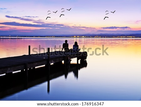 wedding couple on the pier watching the sunrise