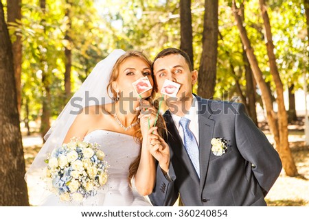 Wedding couple posing with stick lips, mask #360240854