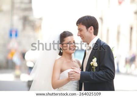 Wedding couple walking in the city in wedding dress  #264025109