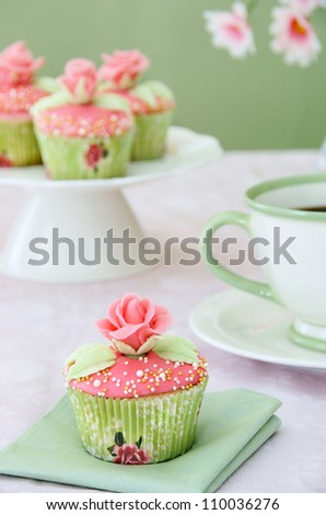 Wedding cupcakes with cup of coffee