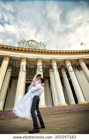 Wedding dance. Bride Groom picked up and circling it and make the wedding dance. Husband kisses his wife on the lips