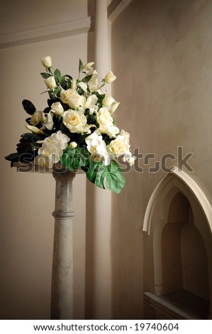 stock photo Wedding day floral arrangement in a church