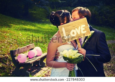 Wedding day - young couple in park
