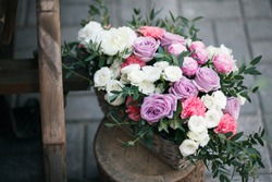 Wedding decor. beautiful flower composition of fresh flowers. concept of a festive dinner, outdoor. rustic style