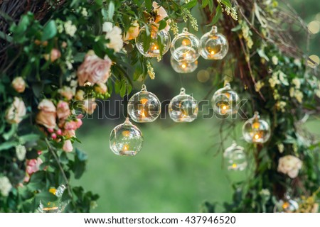 Wedding decor, candles in glass flasks in the forest. #437946520