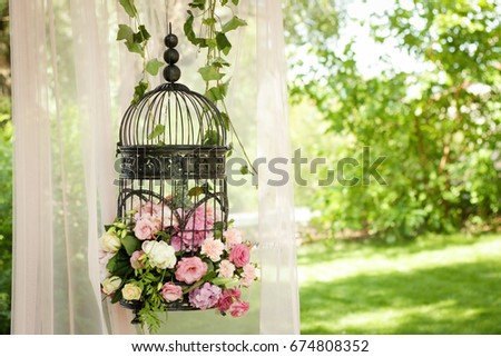 Wedding decor, decor in the trees, flowers in black cages #674808352