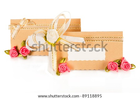 stock photo Wedding decor Invitation card with pearl decoration and roses