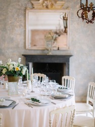 wedding decor, served tables, ivory, with candles, glasses, beautiful wooden tables, inside the Italian old Villa